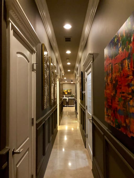 As you enter the unit, you are greeted with a long hallway with lots of glam and drama