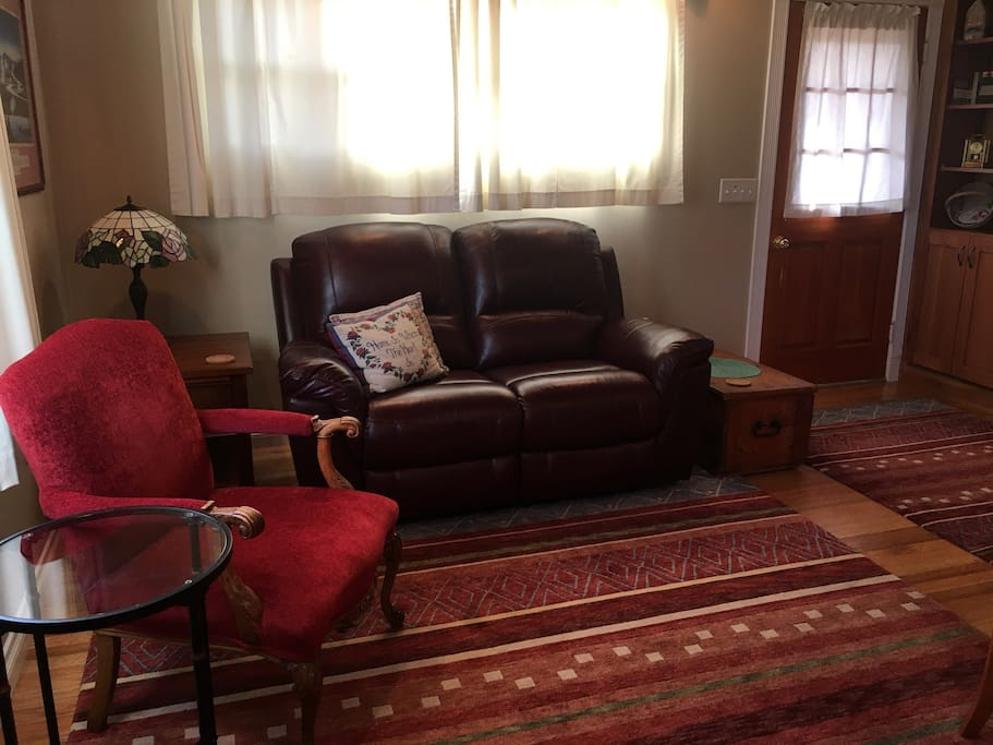 Living Room has double reclining love seat. Perfect for watching TV, reading, enjoying the cozy fireplace or napping!