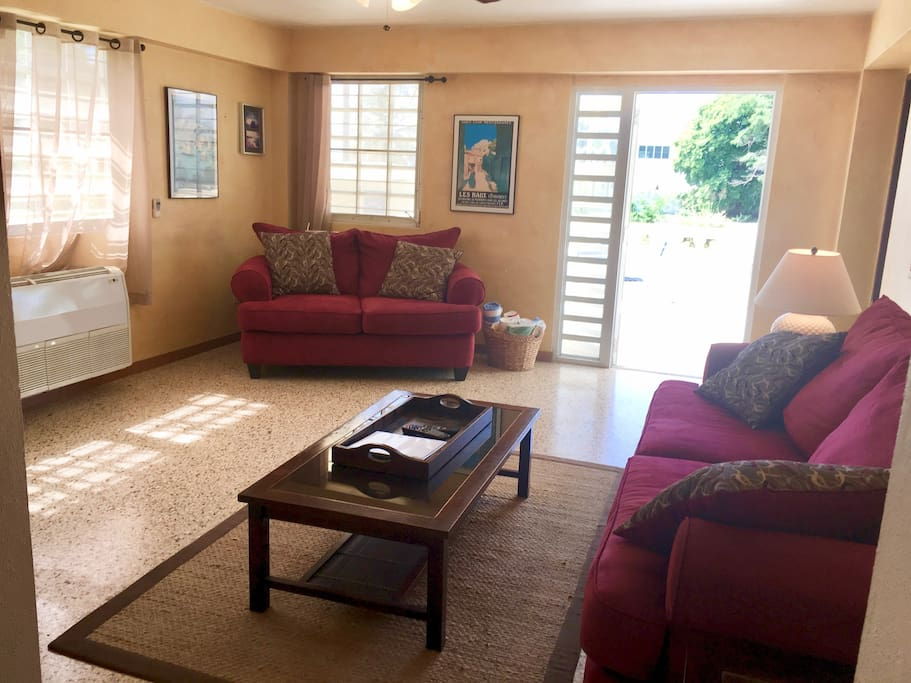 Sunny air-conditioned living room with door out to patio