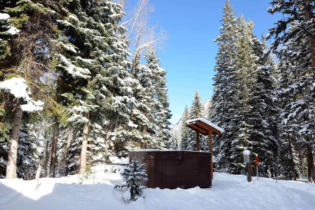 Warm up in the private outdoor hot tub after a day on the slopes
