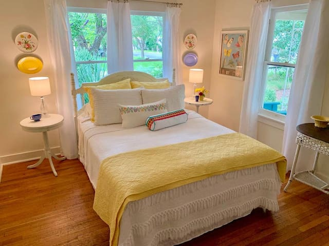 Queen Size Bedroom with views of the front gardens.