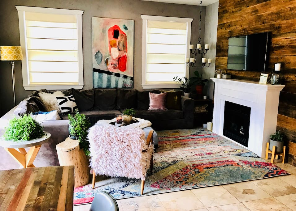 Open living room and kitchen - a perfect gathering space (chairs, and art are always changing:). TV with cable, Netflix and Amazon Prime.  Also, working fireplace:)