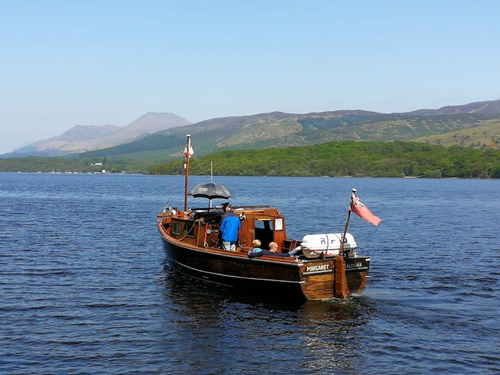 Conic Hill and the Ben  our boatMargaret