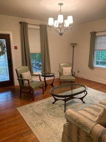 """Living room with 2 chairs. With sofa (on opposite wall--see other photo), seats 5. Also includes a 40"""" smart TV so you can stream your favorite shows. Note that TV is not set up for cable."""