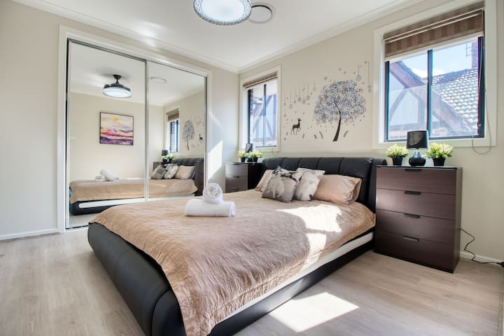 Bedroom with queen size bed and large closet
