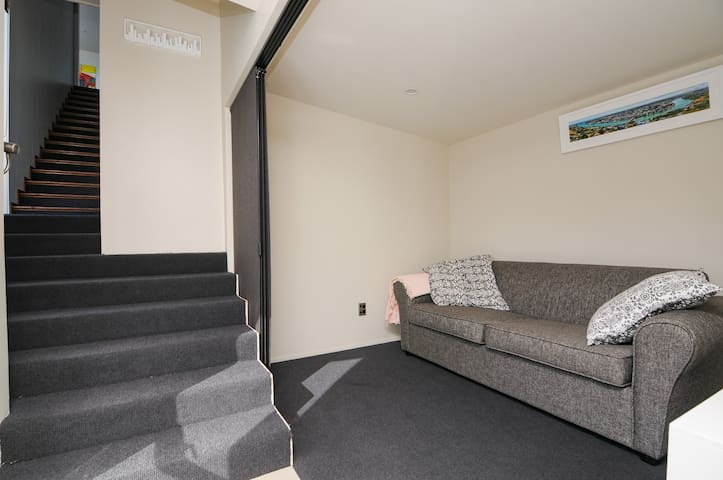 Stairs to Master bedroom.  Extra sleeping space/sofa bed.