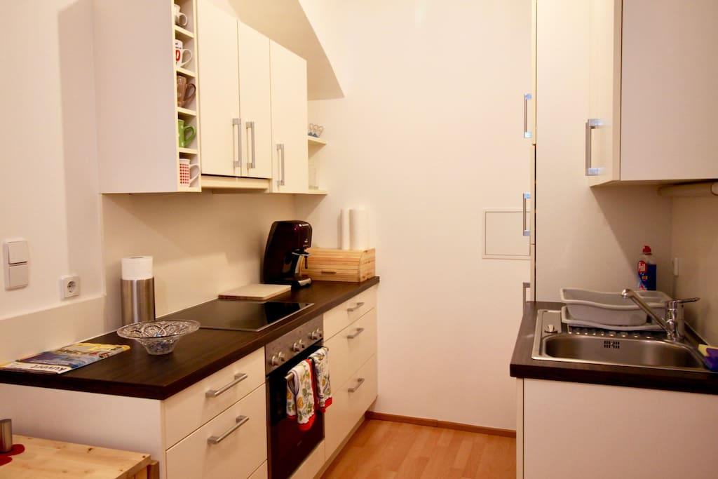 Kitchen equipped with : coffee machine with capsules ( Tchibo ), dishwasher, refrigerator, stove+oven.