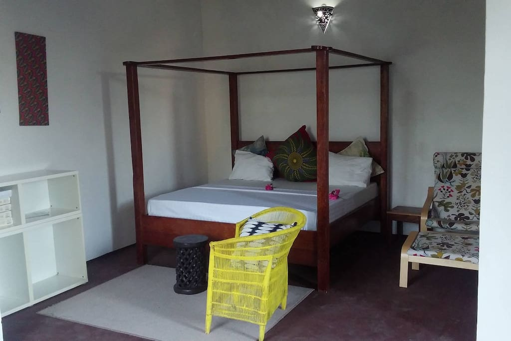 The double bed (includes mosquito net)