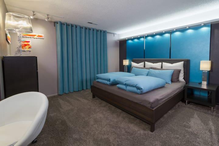 Blue Bedroom: latex King mattress European down comforters & pillows. Desk.