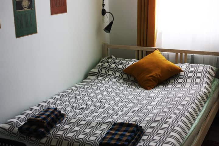 Single room with a large bed in the city center