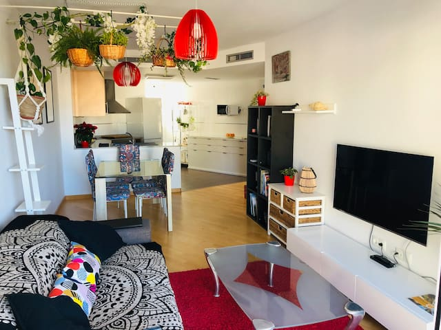 Sunny and cozy apartment with garage and backyard