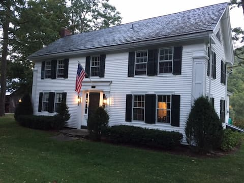 Country Colonial Home with rolling fields & stream