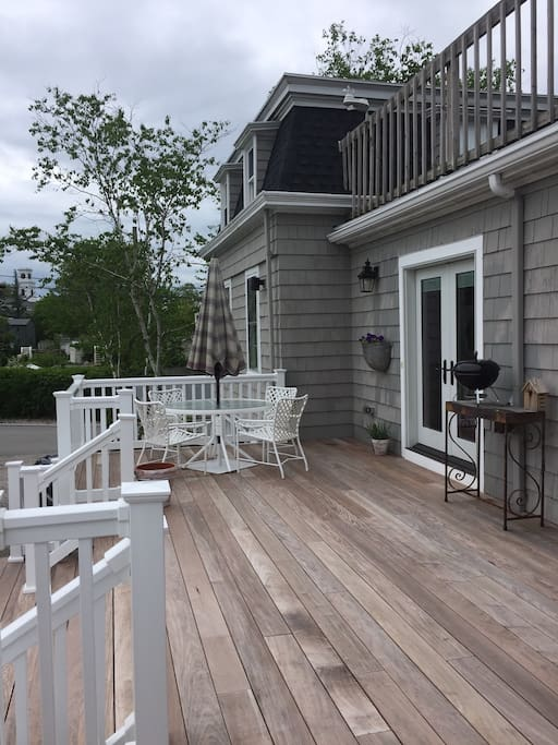 classy deck with staircase to front and rear yard