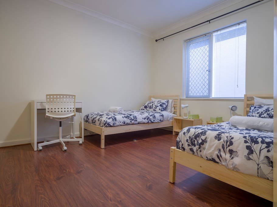 Main Bedroom with 2 Single Beds and Study Desk