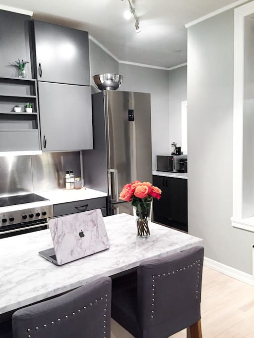 From the kitchen you will be overlooking to the living room area. So you can be social while making food!