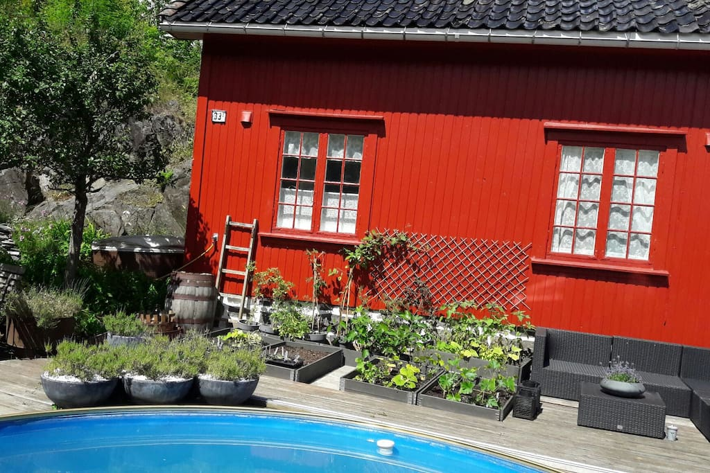 The house is in our garden, with good sunconditions and pool-area.