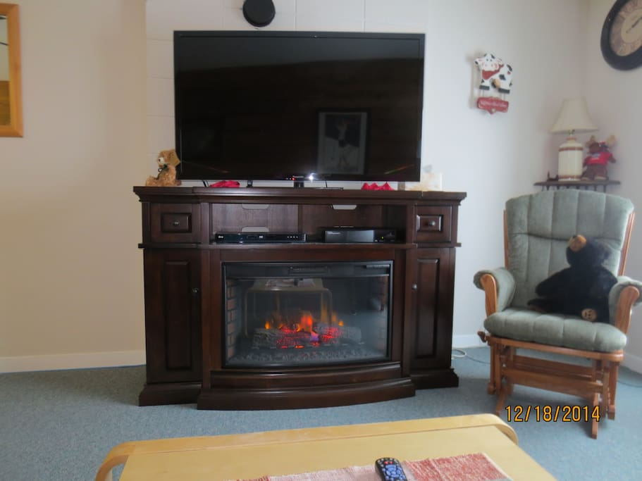 The electric fireplace(cosy) and 55 inch TV