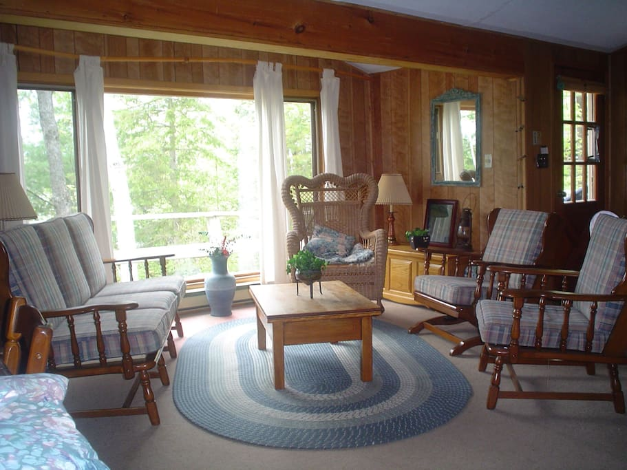 Spacious Living Room w a stereo or to read a book  ( loads of books )    Traditional cottage with lots of character , cozy feel  and  professionally cleaned between rentals.
