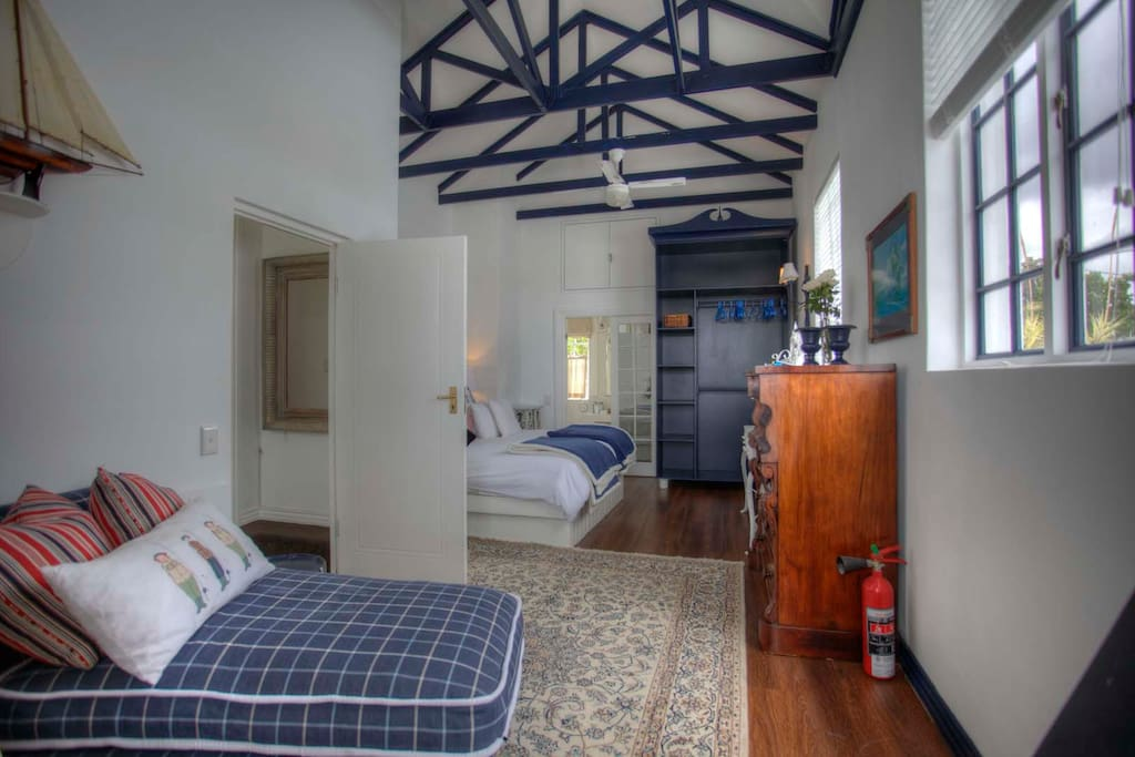 Super nautical inspired en suite bedroom with fireplace and small balcony.