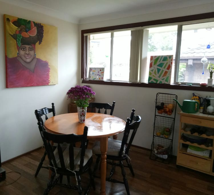 comfortable dining area adjacent to kitchen