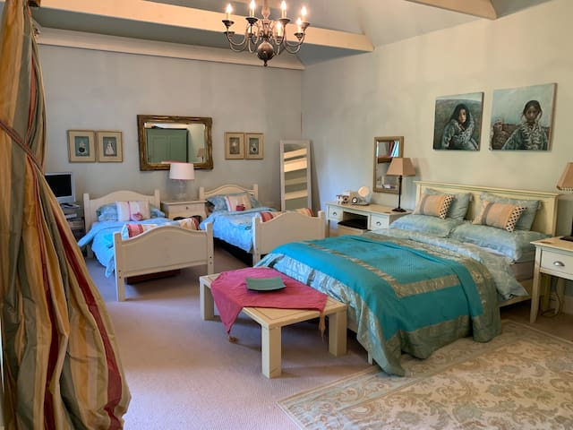 Bedroom - one king and 2 single beds. TV