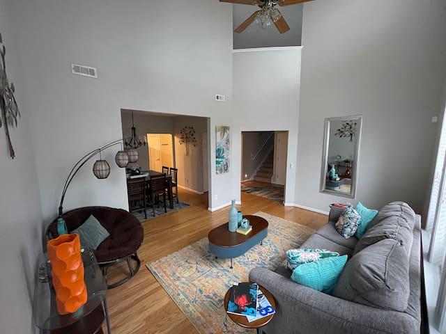 High ceilings den with sleeper sofa (1st floor view)