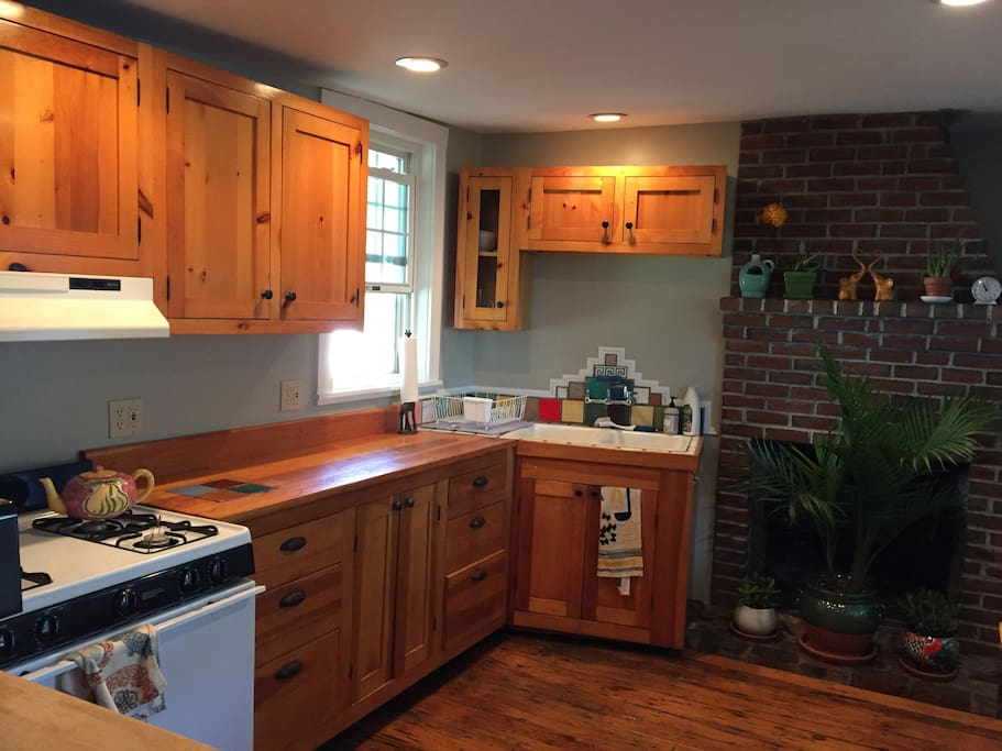 Charming first floor kitchen with amazing natural light and rustic fireplace (inactive but beautiful)