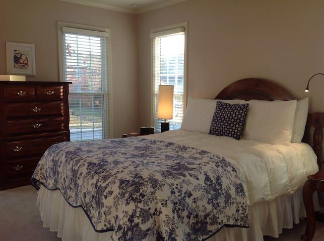 Master bedroom with comfortable queen