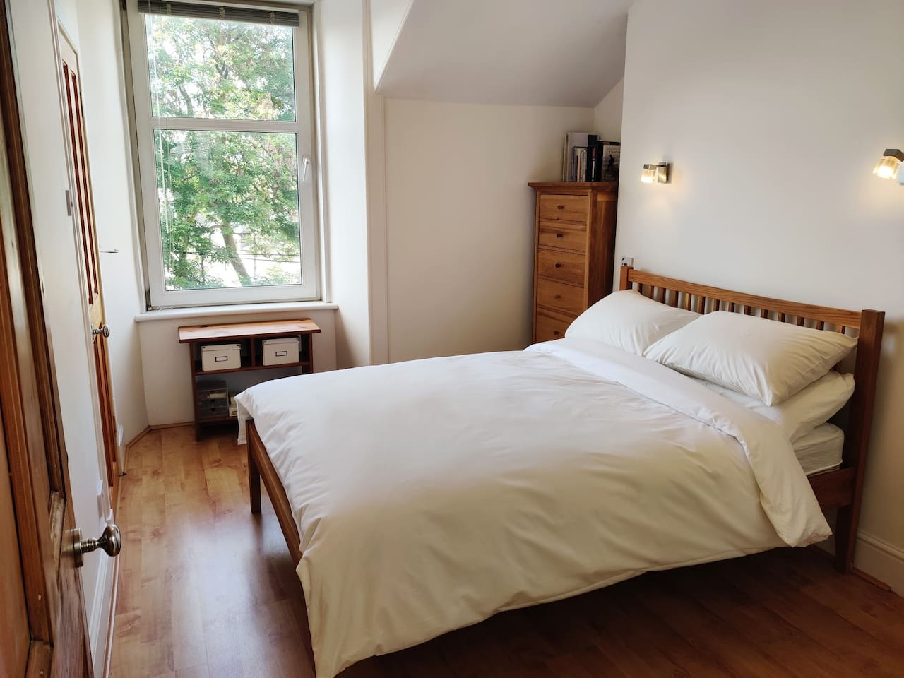 Master Bedroom w/ En-Suite: bright, airy double with peaceful leafy views