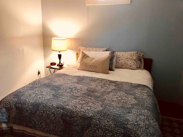 Even a cowboy needs a quiet room at the end of a long day.  Soothing blue tones, luxurious queen size bed and quality linens.  Extra quiet room