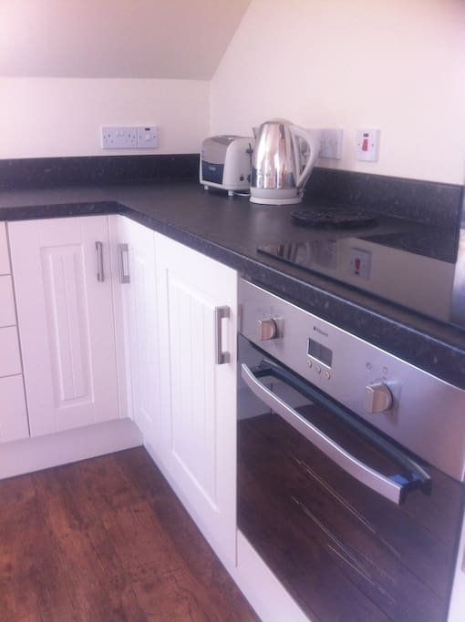 Fully fitted kitchen with integrated appliances