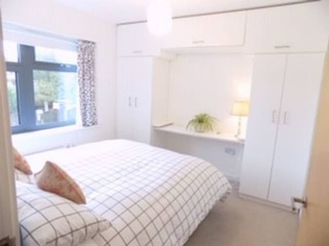 The first bedroom has a double bed and plenty of storage space.
