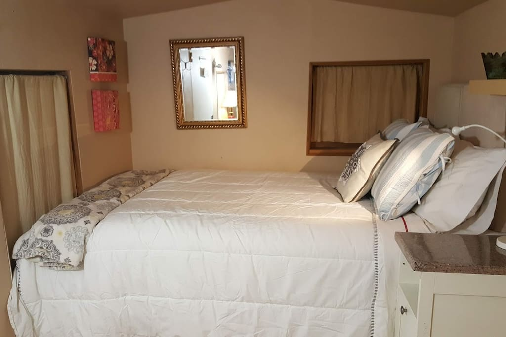 The double bed sleeps two; an extra folding bed can be put into the room. It is slightly smaller than a twin-sized bed. Please note: 2 beds are available if needed. But the larger double bed seen here is the only stationary bed.  We've recently added a great nightstand.