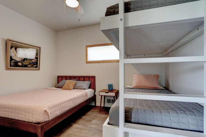 Queen bed with two built in bunks.