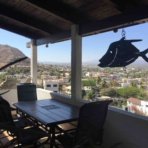 Sit out on the terrace and take in the amazing view of  the entire city of Cabo  mountain and ocean view