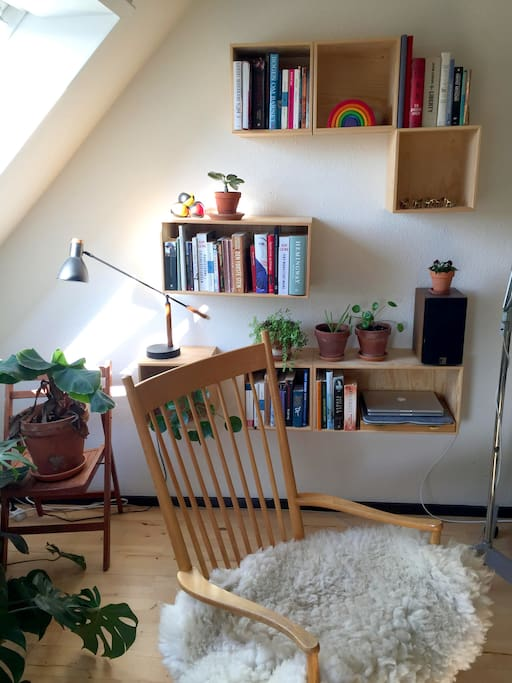 The living room. We didn't know what to do with the wall space so we make our own shelfsystem a few years ago :)