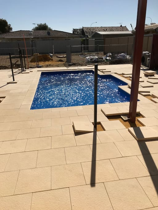 Heated Swimming Pool nearly finished - fenced