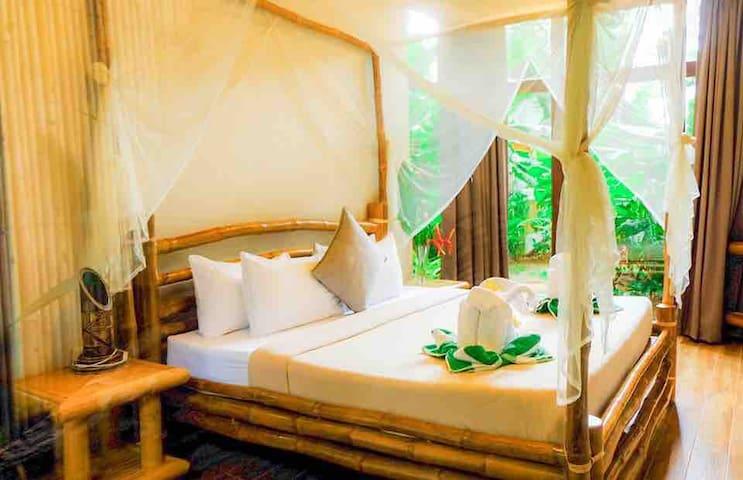 Bedroom 2 downstairs with en suite semi outdoor bathroom