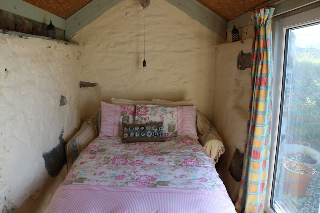 The cosy yet comfortable double bed.