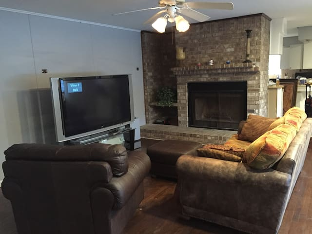 Living Room with 60 inch TV and Fireplace
