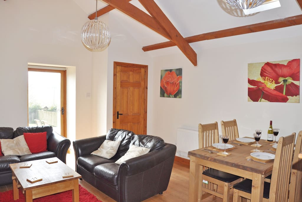 Ground floor spacious open plan sitting room with high pitched ceiling