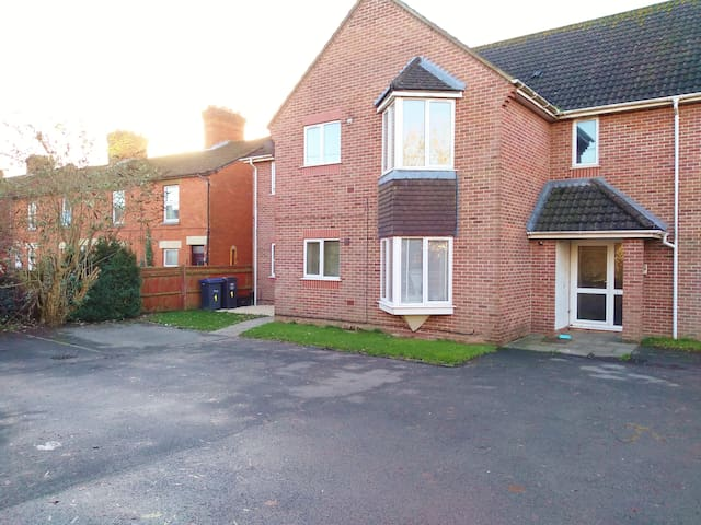 easy access to the ground floor flat with designated parking next to a private entrance at the side.