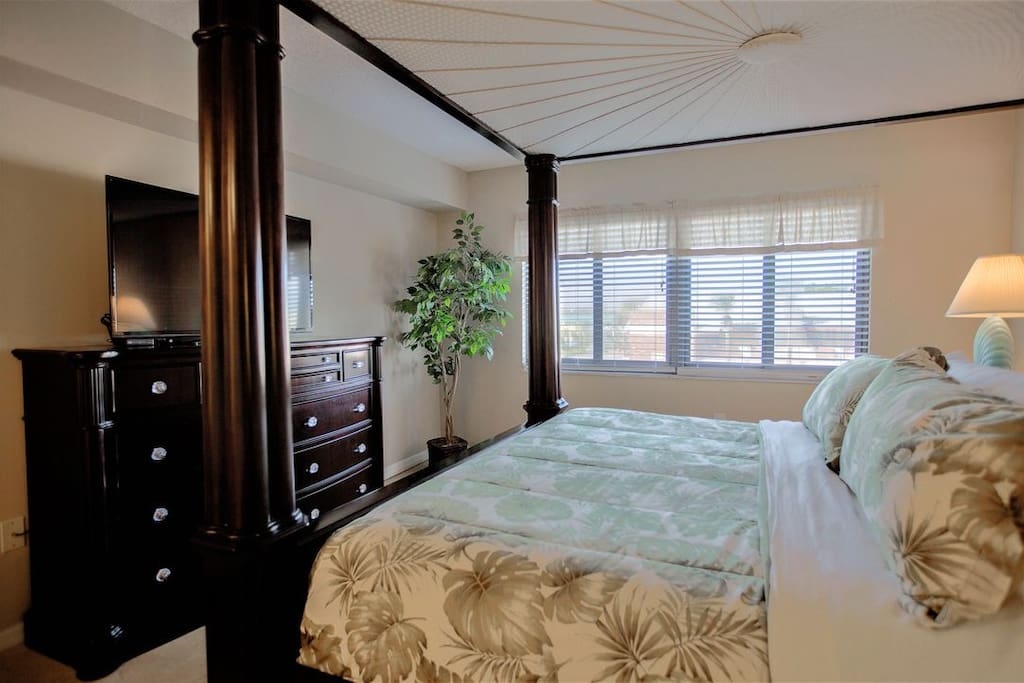 "Master bedroom - king bed, 48"" TV, ensuite washroom, walk-in closet"