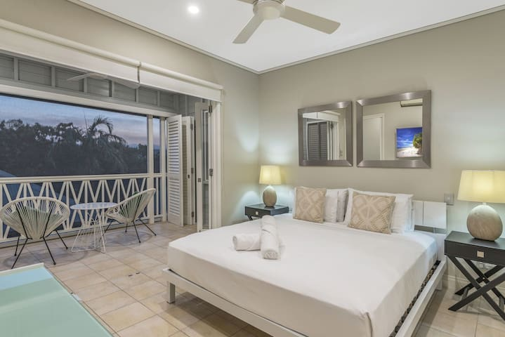 Three bedroom holiday accommodation in the heart of Port Douglas village Master Bedroom with ensuite