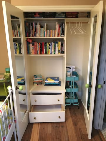 Closet area has room to hang some items and empty drawers.