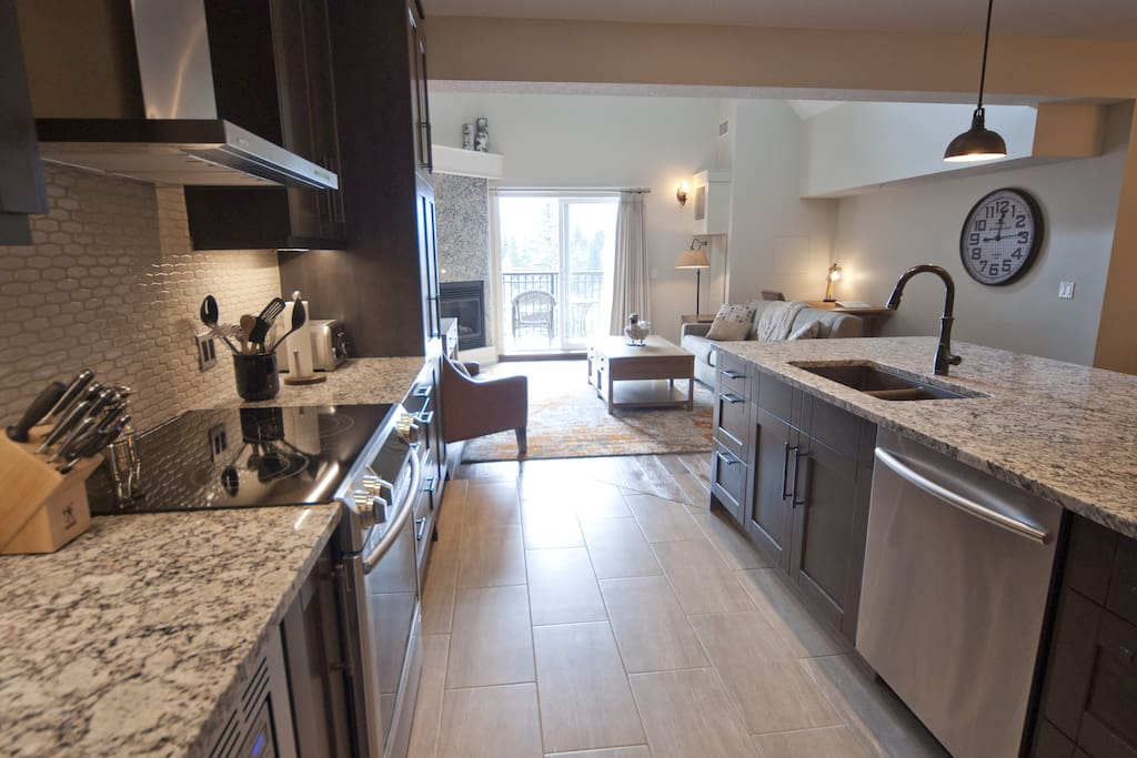 Spacious kitchen is open to the dining area, living room and bonus seating area.