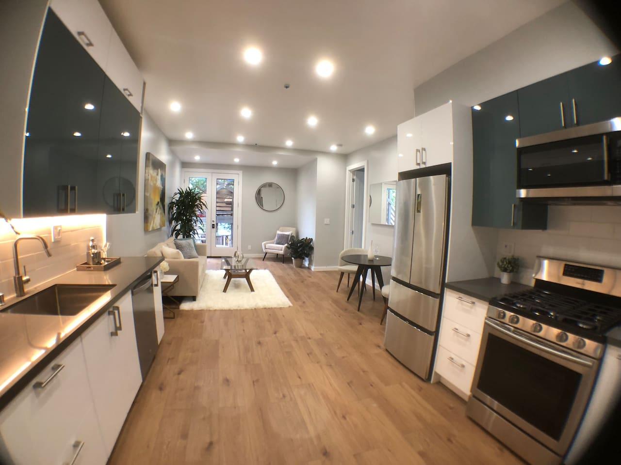 Open floor plan kitchen + living area