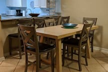 Dining table and breakfast bar with seating for 8