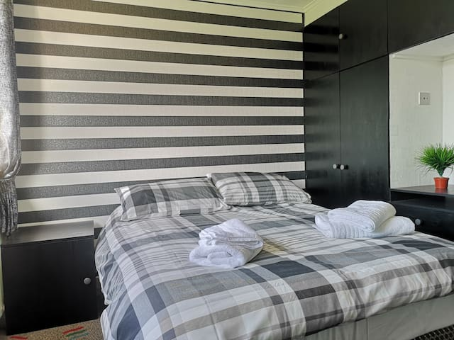 Bedroom two (double), guests have the use of a double wardrobe, bedside cabinet and a six drawer unit.