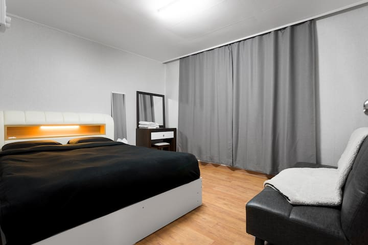 This is the biggest bedroom, with an AC, a latex-topped queen bed, a fold-down sofa bed and a closet, with black out curtains.